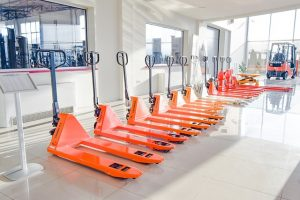 Orange forklifts placed in a row