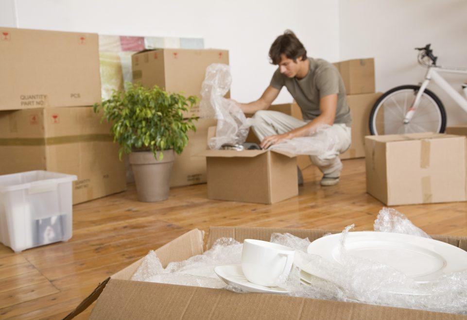 Man unpacking moving boxes