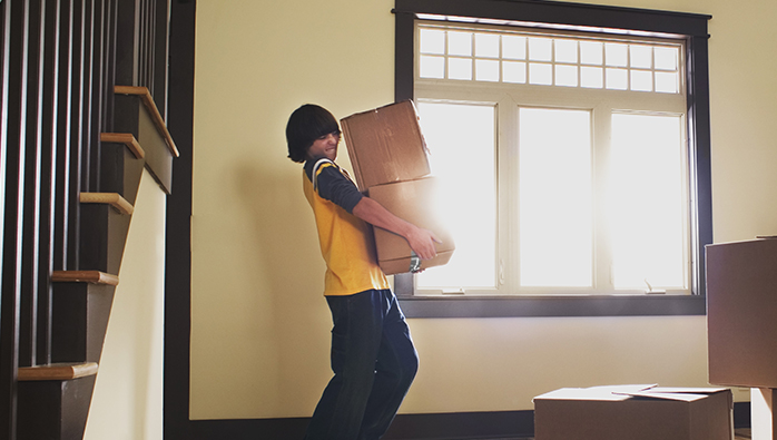 Boy carrying boxes