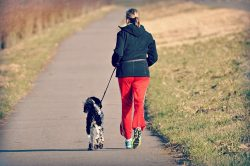 -a woman running with a dog