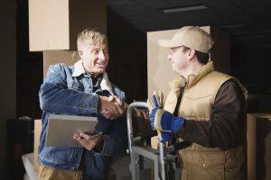 Customer shaking hands - binding moving estimate