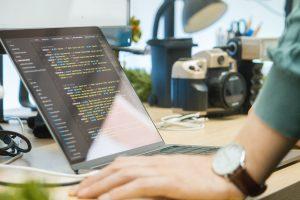 Programmer at a desk.