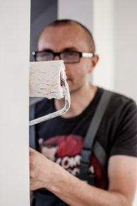 man painting apartment to cheap NYC apartments for rent