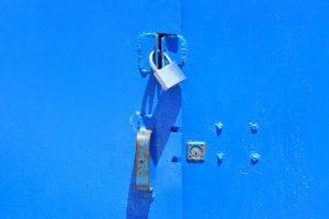 Lock on a blue door.