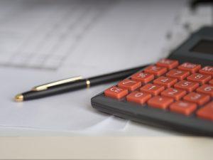 calculator and a pen