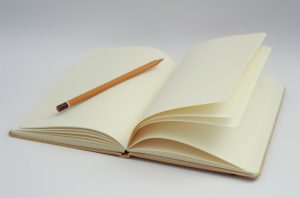 notebook with pencil and packing tips for businesses