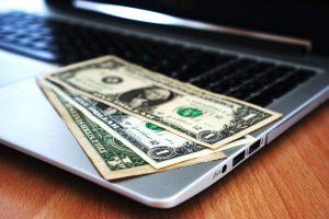 dollar bill on a computer