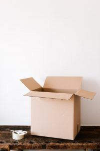 packing boxes on a table are a way to save money on a long distance relocation